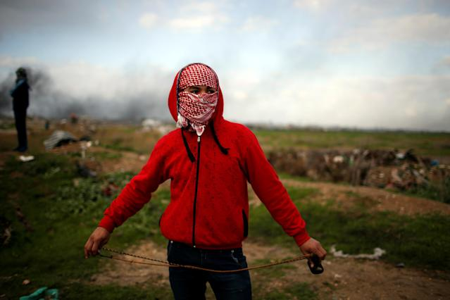 """<p>A Palestinian protester holds a sling as he poses for a photograph at the scene of clashes with Israeli troops near the border with Israel, east of Gaza City, Jan. 19, 2018. """" I hope I can live my dreams, I always dreamt of a job and of freedom of movement,"""" he said. (Photo: Mohammed Salem/Reuters) </p>"""