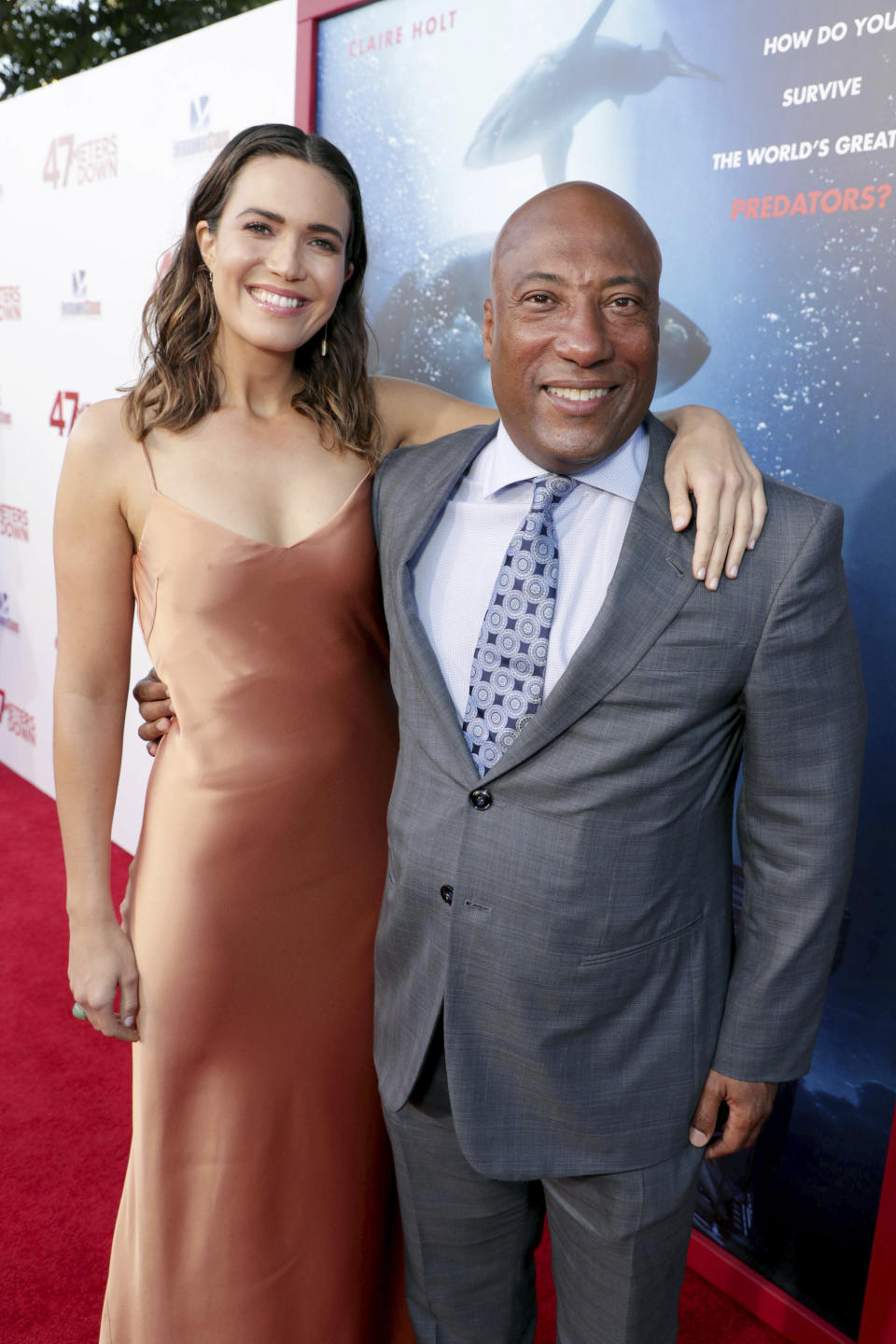 """Mandy Moore and Byron Allen, Chairman and CEO of Entertainment Studios, seen at Entertainment Studios Motion Pictures """"47 Meters Down"""" Los Angeles Premiere at Regency Village Theatre on Monday, June 12, 2017, in Los Angeles. (Photo by Eric Charbonneau/Invision for Entertainment Studios Motion Pictures/AP Images)"""