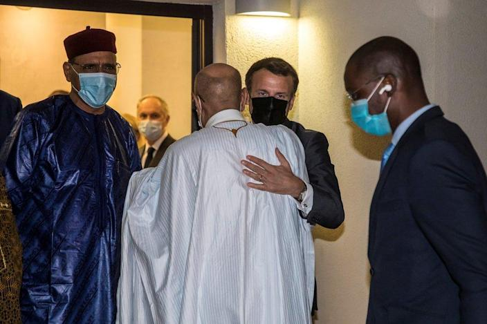 """French President Emmanuel Macron greets President of Mauritania Mohamed Ould Cheikh El Ghazouani next to Niger""""s President Mohamed Bazoum after a meeting with African leaders of the Sahel countries as part of the funerals of Chad President Idriss Deby in N""""Djamena, Chad, April 22, 2021."""