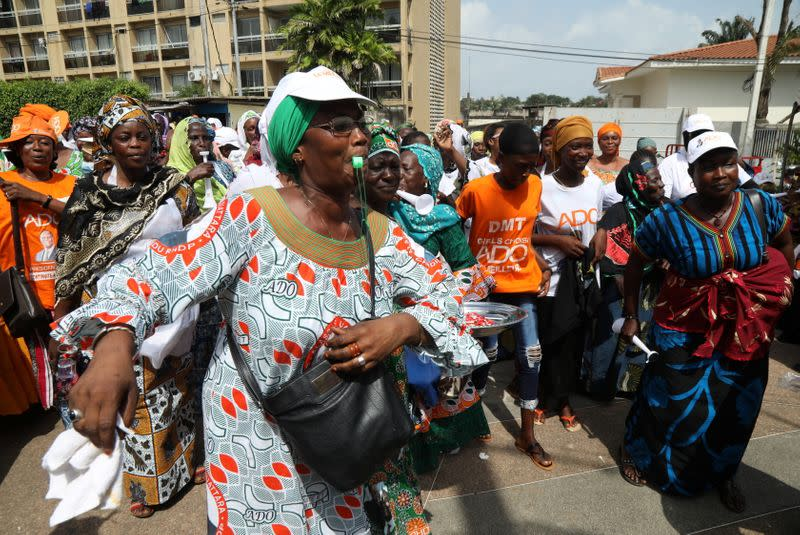 Supporters of Ivory Coast's re-elected President Alassane Ouattara of the ruling RHDP coalition party, celebrate his victory in the re-election in Abidjan