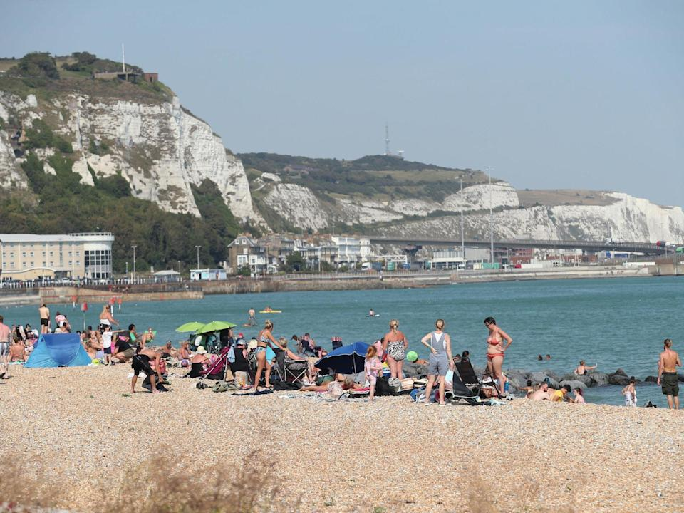 Beachgoers enjoy the hot weather in Dover, Kent, on 9 August, 2020: Yui Mok/PA