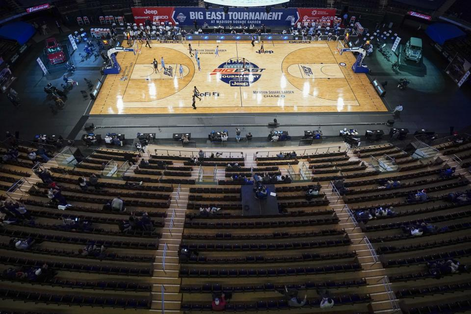 Fans watch Georgetown play Creighton during the second half of an NCAA college basketball game for the championship of the Big East men's tournament Saturday, March 13, 2021, in New York. Georgetown won 73-48. (AP Photo/Frank Franklin II)