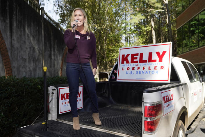 Republican candidate for Georgia's 14th congressional seat Marjorie Taylor Greene speaks from the bed of a pickup truck during a campaign rally Saturday, Oct. 31, 2020, in Roswell, Ga. (AP Photo/John Bazemore)