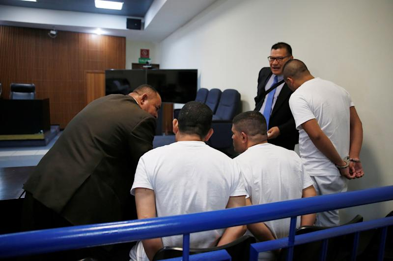 Three former El Salvador police officers, seen here conferring with their lawyers during their trial, were found guilty in late July of aggravated homicide in the killing early last year of Diaz Córdova. For years, members of El Salvador's LGBTQ community have been especially vulnerable to violence in the nation. (Photo: Jose Cabezas / Reuters)