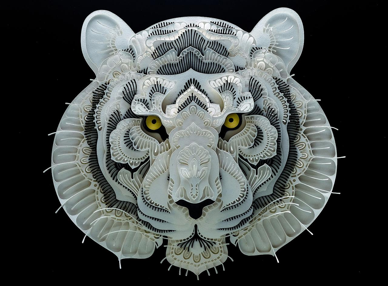 <p>Intricate paper cut out of a tiger. (Photo: Patrick Cabral/Caters News </p>