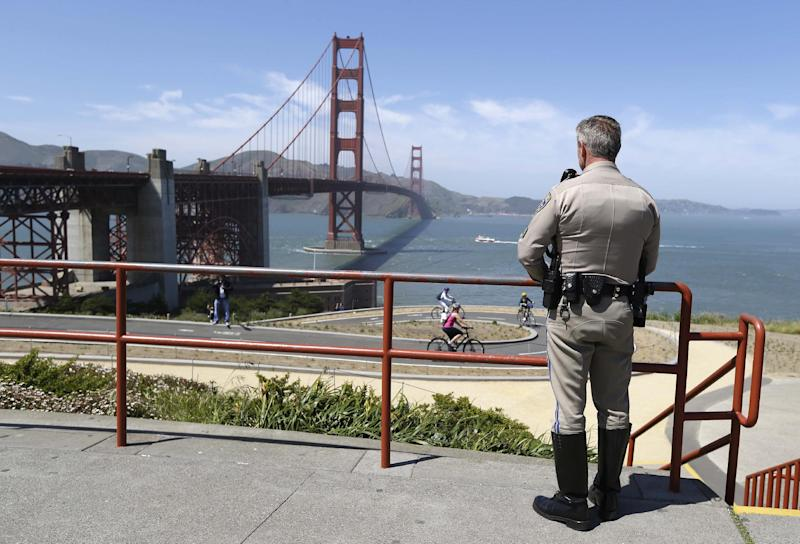 In this photo taken Tuesday, April 30, 2013 California Highway Patrol Sergeant Kevin Briggs looks out at the Golden Gate Bridge in San Francisco. About 1,500 people have plunged from the bridge, making it one of the world's favorite suicide spots. During his 20 years patrolling the bridge Briggs has managed to talk may despondent people out of taking the fatal fall. (AP Photo/Eric Risberg)