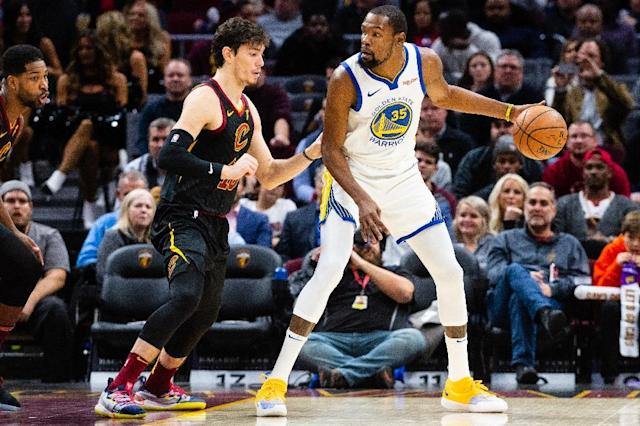 Golden State star Kevin Durant faces down Cleveland's Cedi Osman in the Warriors' 129-105 NBA victory over the Cavaliers (AFP Photo/Jason Miller)