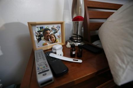 A portrait of Roberto Marrero and his wife Romy Moreno is seen next to a bed at the residence of Marrero, former chief of staff to opposition leader Juan Guaido, after he was detained in Caracas