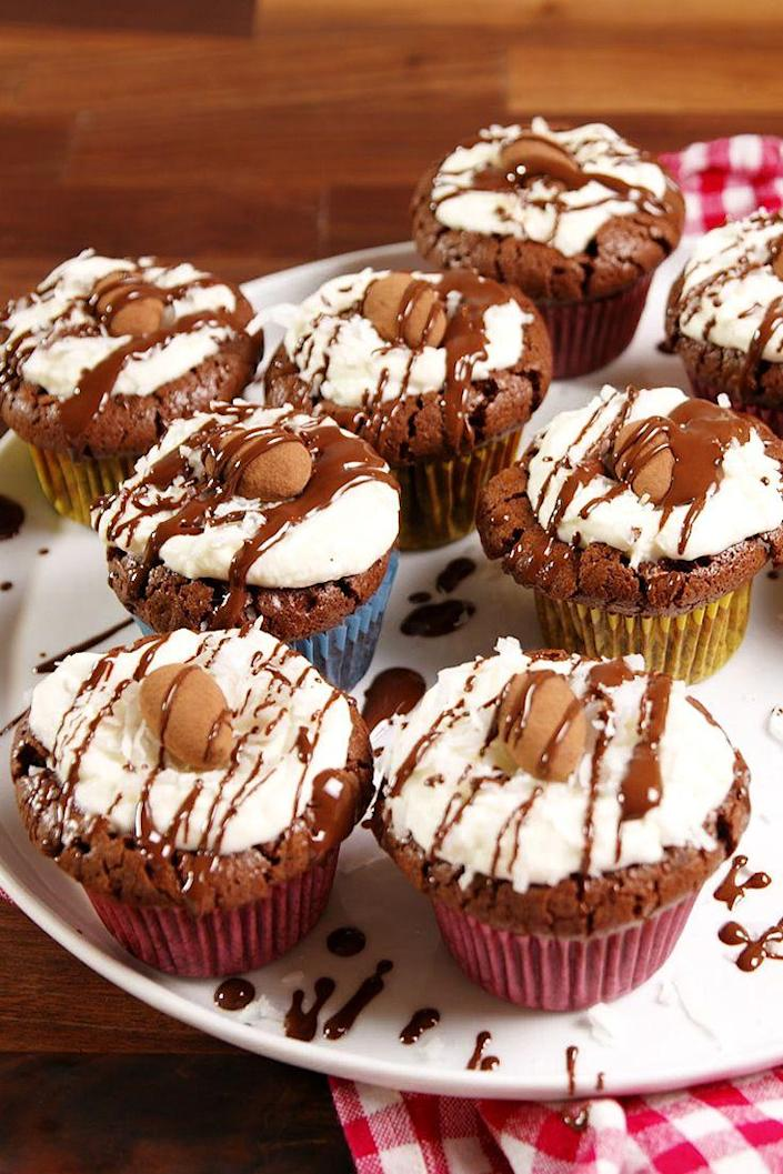 """<p>Candy-inspired cupcakes are the way to go this Halloween.</p><p>Get the recipe from <a href=""""https://www.delish.com/cooking/recipe-ideas/recipes/a51438/almond-joy-cupcakes-recipe/"""" rel=""""nofollow noopener"""" target=""""_blank"""" data-ylk=""""slk:Delish"""" class=""""link rapid-noclick-resp"""">Delish</a>.</p>"""