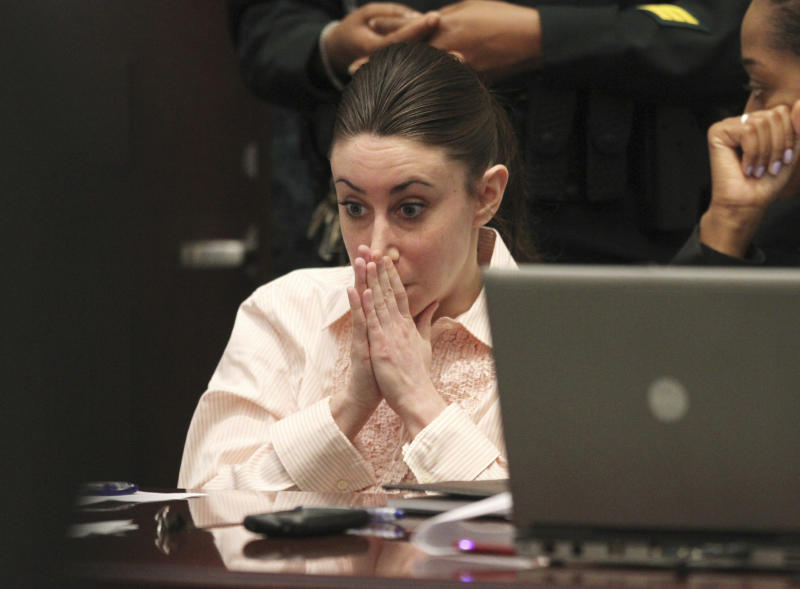 Casey Anthony reacts as her father, George Anthony, testifies during her murder trial in Orlando, Fla., Wednesday, June 29, 2011.  Casey Anthony,  25, has pleaded not guilty to first-degree murder in the death of her daughter,  2-year-old Caylee Anthony, and could face the death penalty if convicted of that charge.  (AP Photo/Red Huber, Pool)