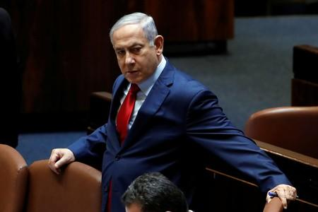 Israeli Prime Minister Benjamin Netanyahu arrives to the plenum at the Knesset, Israel's parliament, in Jerusalem