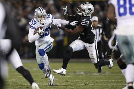 Dec 17, 2017; Oakland, CA, USA; Dallas Cowboys wide receiver Terrance Williams (83) runs with the ball after making a catch next to Oakland Raiders cornerback Dexter McDonald (23) in the first quarter at Oakland Coliseum. Mandatory Credit: Cary Edmondson-USA TODAY Sports