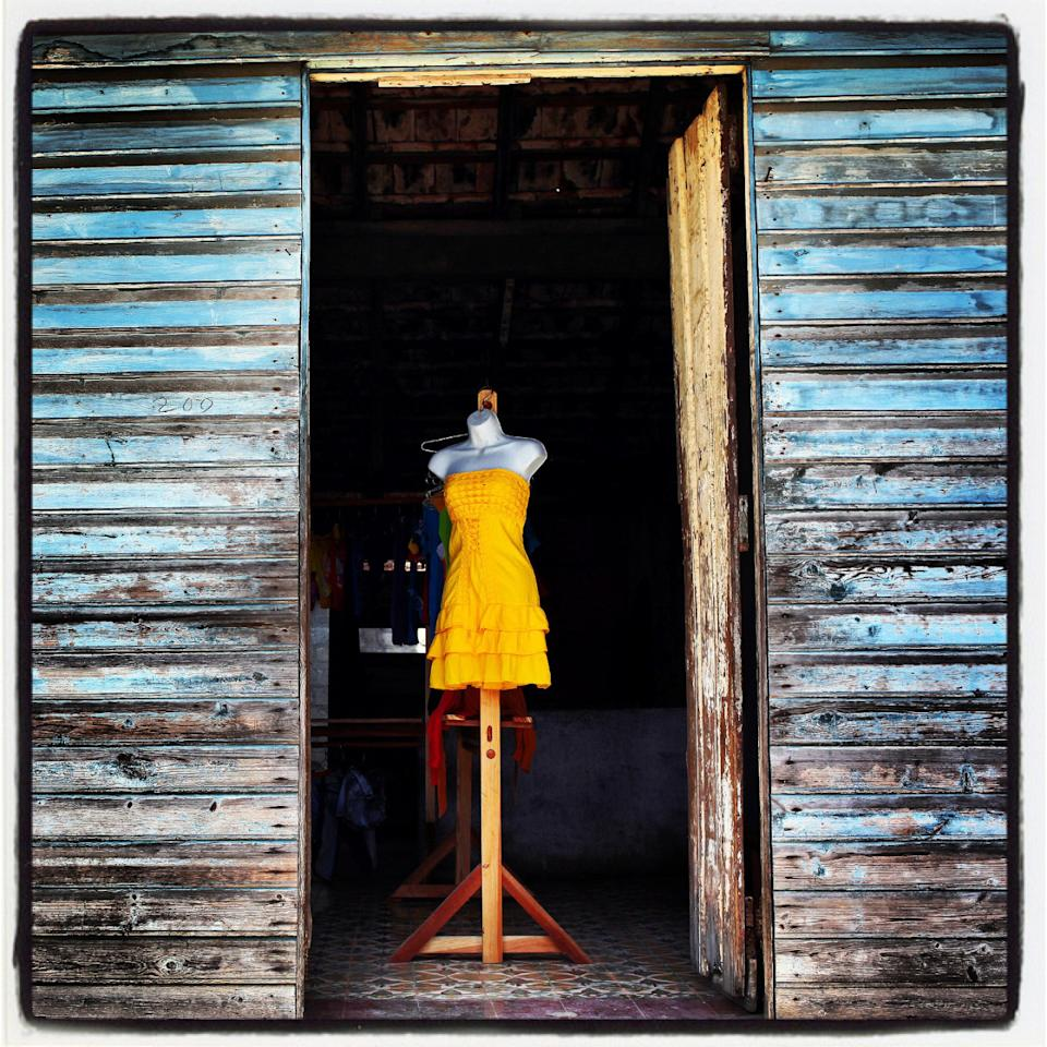 "<p>A dress is displayed in a private exhibit in the eastern Cuban town of Baracoa, which was the first village founded by the Spaniards during the colonization of the island<i>. (Photo: Alejandro Ernesto Pérez Estrada via <a href=""http://zuma24.com/"">ZumaPress</a>)</i></p>"