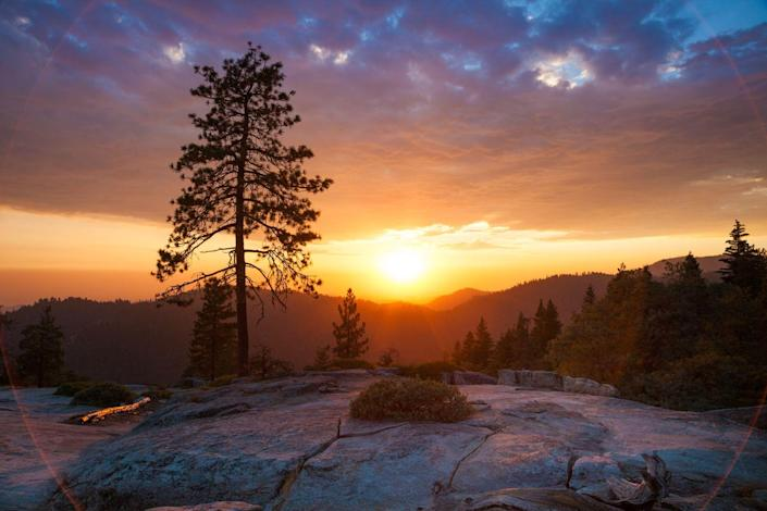 <p>The sun sets over Beetle Rock in Sequoia National Park, California. // August</p>