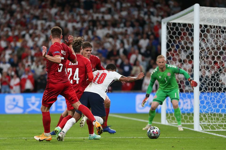 LONDON, ENGLAND - JULY 07: Raheem Sterling of England is fouled by Mathias Jensen of Denmark leading to a penalty being awarded during the UEFA Euro 2020 Championship Semi-final match between England and Denmark at Wembley Stadium on July 07, 2021 in London, England. (Photo by Alex Morton - UEFA/UEFA via Getty Images)