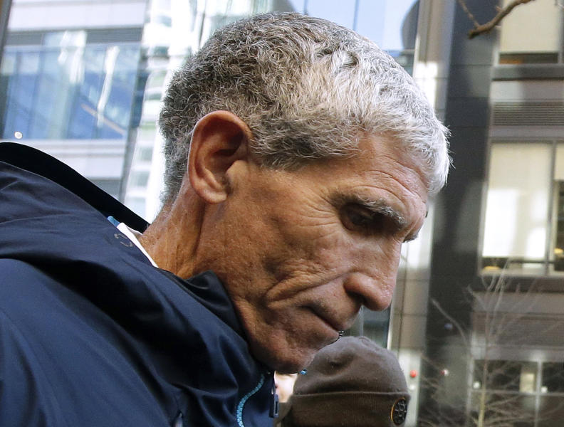 """FILE - In this March 12, 2019, file photo, William """"Rick"""" Singer, founder of the Edge College & Career Network, leaves federal court in Boston after pleading guilty to charges in a nationwide college admissions bribery scandal. Stanford University says it conducted a review that found the mastermind behind the college admissions bribery scandal had approached seven coaches about potential sports recruits over the past decade. Only one of them, sailing coach John Vandemoer, went along with the scheme proposed by Singer, it says. Stanford also says it has adopted new policies to strengthen admission oversight. (AP Photo/Steven Senne, File)"""