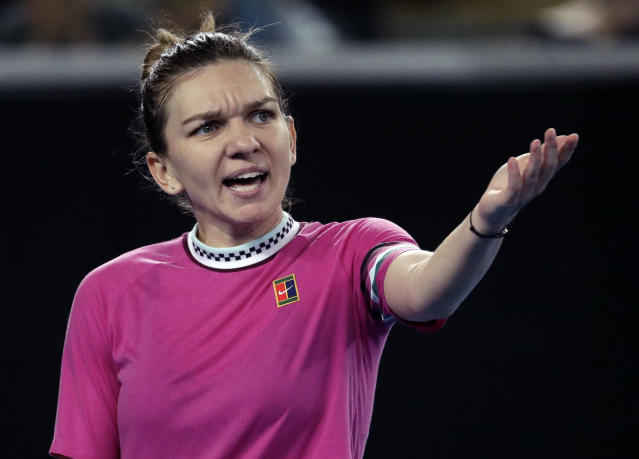 Romania's Simona Halep gestures during her first round match against Estonia's Kaia Kanepi at the Australian Open tennis championships in Melbourne, Australia, Tuesday, Jan. 15, 2019. (AP Photo/Mark Schiefelbein)