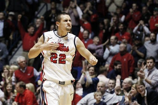 Mississippi guard Marshall Henderson (22) celebrates while leaving the court in the final seconds of their NCAA college basketball game against Tennessee, Thursday, Jan. 24, 2013, in Oxford, Miss. Mississippi won 62-56. (AP Photo/Rogelio V. Solis)