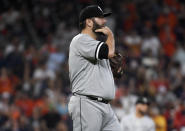 Chicago White Sox starting pitcher Lance Lynn walks back to the mound after Houston Astros' Robel Garcia hit a three-run double during the third inning of a baseball game, Saturday, June 19, 2021, in Houston. (AP Photo/Eric Christian Smith)