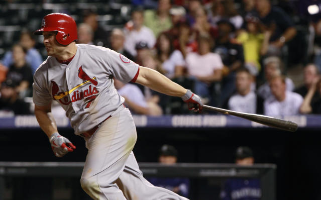 St. Louis Cardinals' Matt Holliday singles against the Colorado Rockies in the seventh inning of the Cardinals' 11-4 victory in a baseball game in Denver on Tuesday, Sept. 17, 2013. (AP Photo/David Zalubowski)