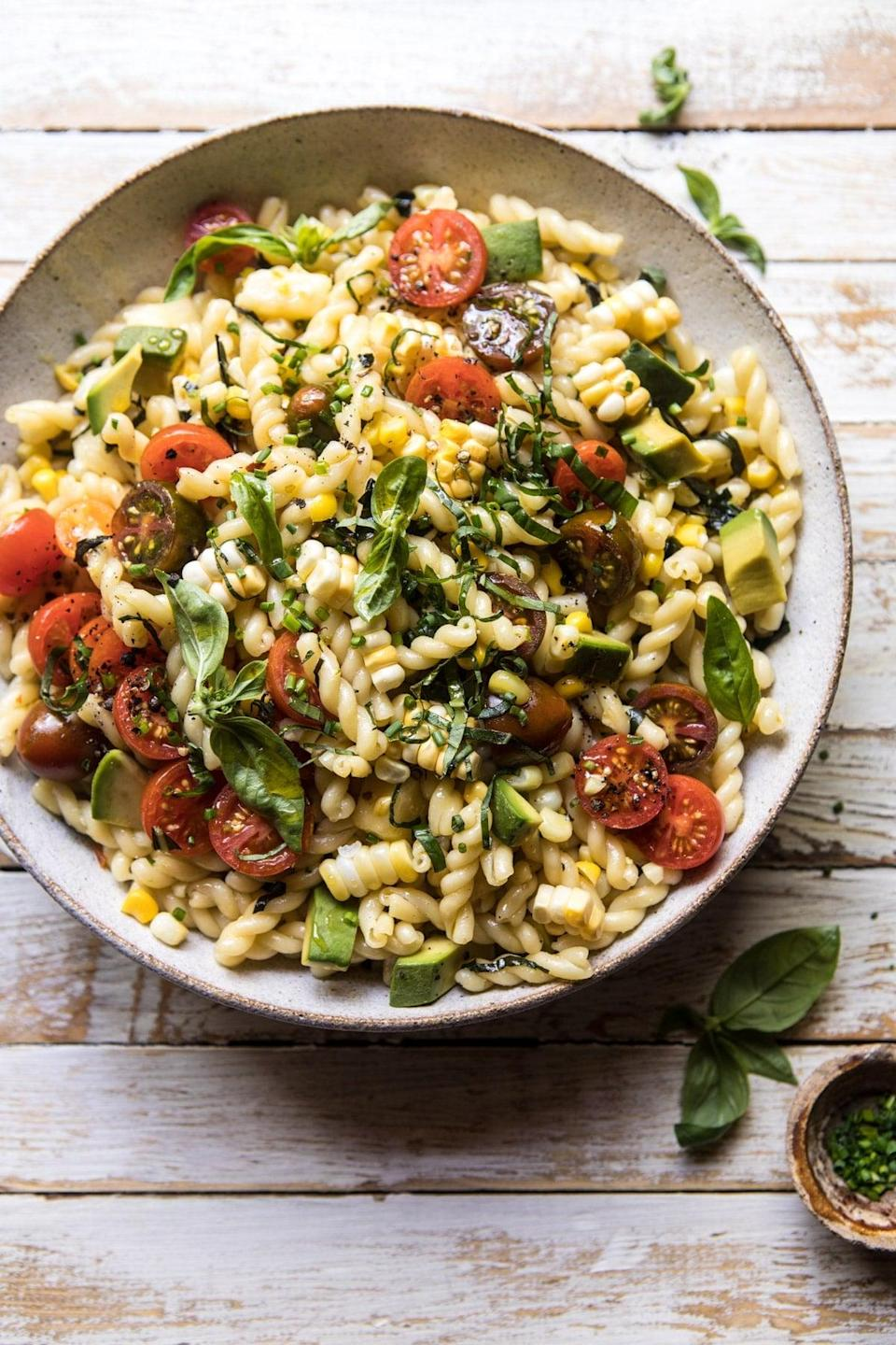 """<p>Need something both healthy and filling? Throw together this pasta salad which features a hint of cheddar cheese that gives it an extra kick. We suggest adding extra corn if you're a fan of the veggie because it adds a ton of flavor.</p> <p><strong>Get the recipe:</strong> <a href=""""http://www.halfbakedharvest.com/corn-tomato-and-avocado-pasta-salad/"""" class=""""link rapid-noclick-resp"""" rel=""""nofollow noopener"""" target=""""_blank"""" data-ylk=""""slk:corn, tomato, and avocado pasta salad"""">corn, tomato, and avocado pasta salad</a></p>"""