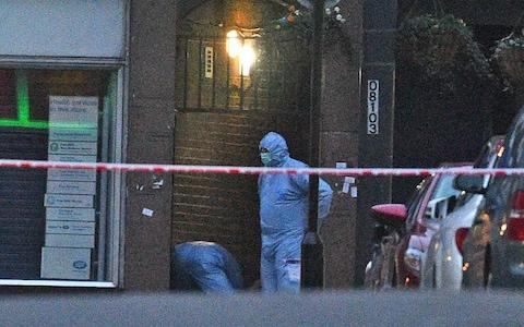 <span>Police forensic officers at the scene in Streatham High Road</span> <span>Credit: Kirsty O'Connor/PA Wire </span>