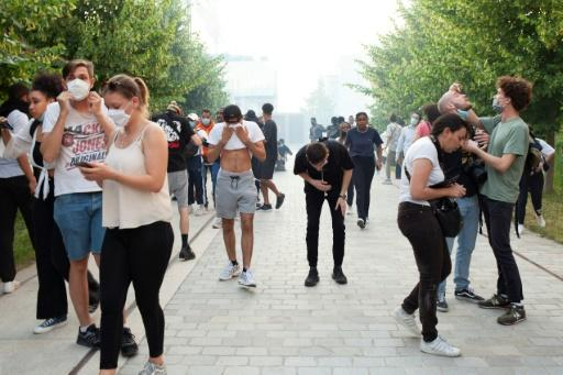 Protesters suffer from police tear gas at the rally
