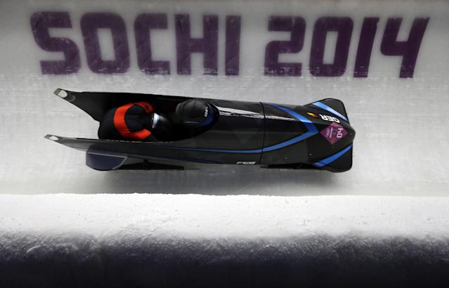 The team from Germany GER-1, piloted by Francesco Friedrich and brakeman Jannis Baecker, take a curve during the men's two-man bobsled competition at the 2014 Winter Olympics, Monday, Feb. 17, 2014, in Krasnaya Polyana, Russia. (AP Photo/Natacha Pisarenko)