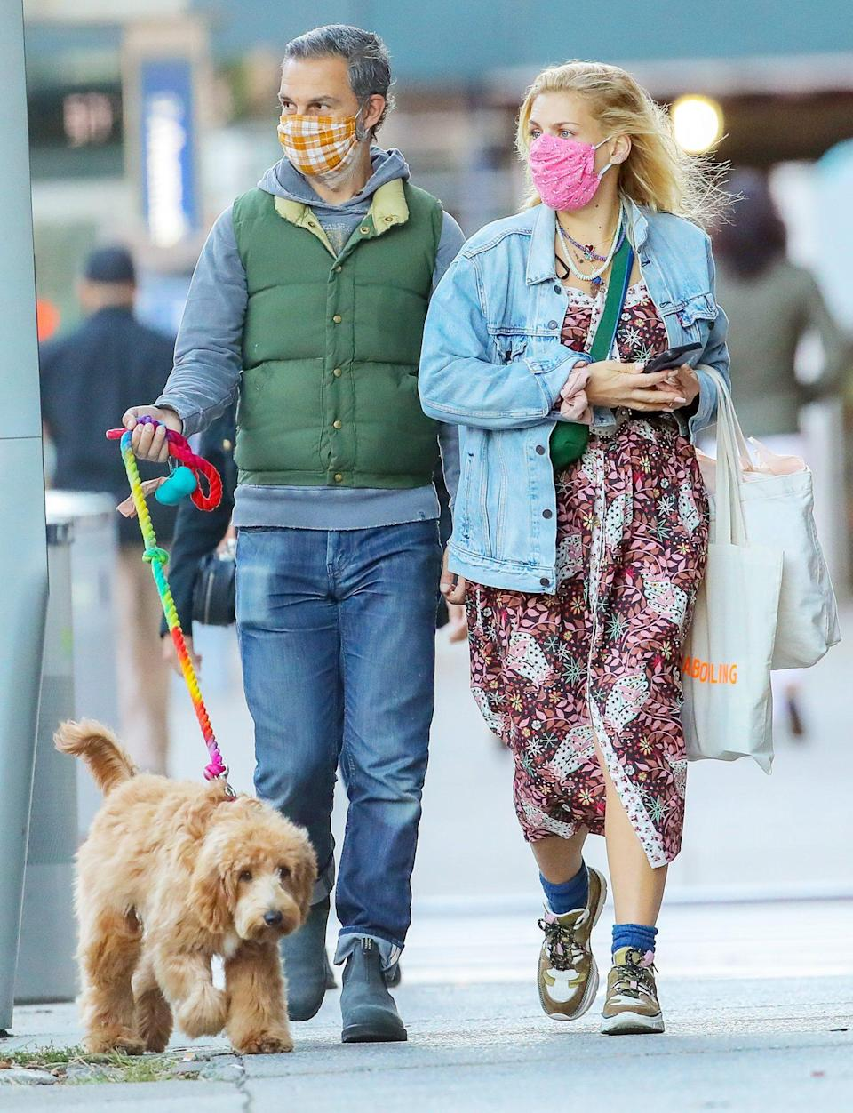 <p>Busy Philipps and husband Marc Silverstein take their pup for a walk through N.Y.C. on Sunday.</p>