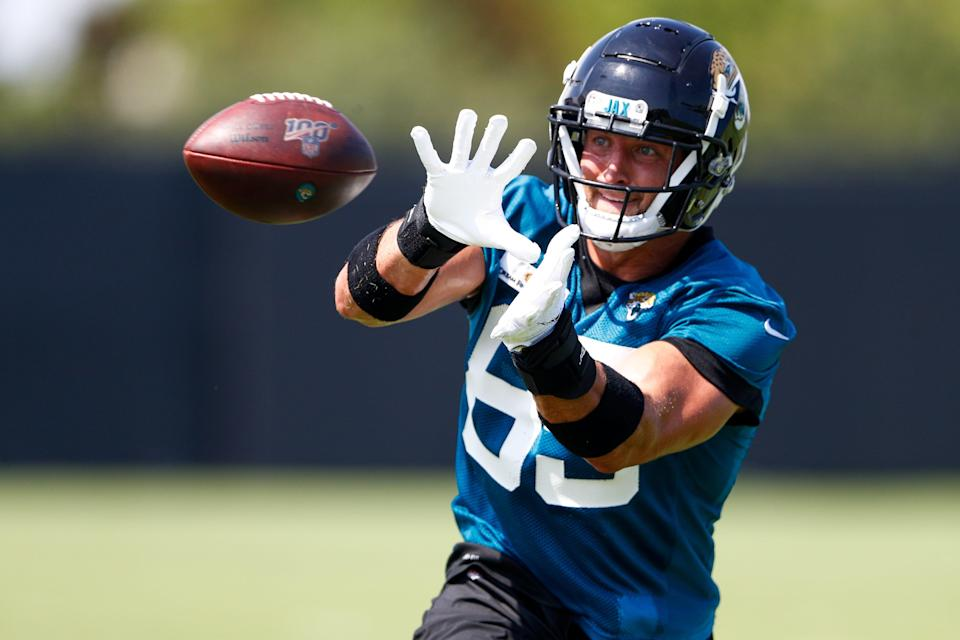 Jaguars tight end Tim Tebow participates in passing drills during minicamp.