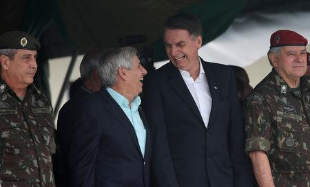 Brazil's President-elect Jair Bolsonaro talks with retired General Augusto Heleno during an event to celebrate the 73rd anniversary of Brazilian Paratrooper Infantry Brigade in Rio de Janeiro, Brazil November 24, 2018. Picture taken November 24, 2018. REUTERS/Ricardo Moraes