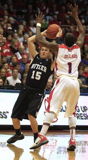 Butler's Rontei Clarke (15) feels the defensive pressure from Dayton's Kevin Dilliard during the first half of an NCAA college basketball game, Saturday, Jan. 12, 2013, in Dayton, Ohio. (AP Photo/Skip Peterson)
