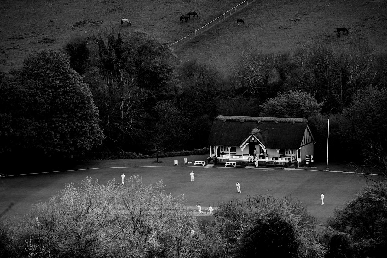 MONKTON COMBE, ENGLAND - APRIL 27: (EDITORS NOTE: Image has been shot in black and white. Color version not available.)  A general view of play from Monkton Combe Cricket Club on April 27, 2008 in Monkton Combe, England.  (Photo by Laurence Griffiths/Getty Images)
