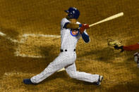 Chicago Cubs' David Bote hits a three-run home run during the sixth inning of Game 2 of a baseball doubleheader against the St. Louis Cardinals, Monday, Aug. 17, 2020, in Chicago. (AP Photo/Matt Marton)