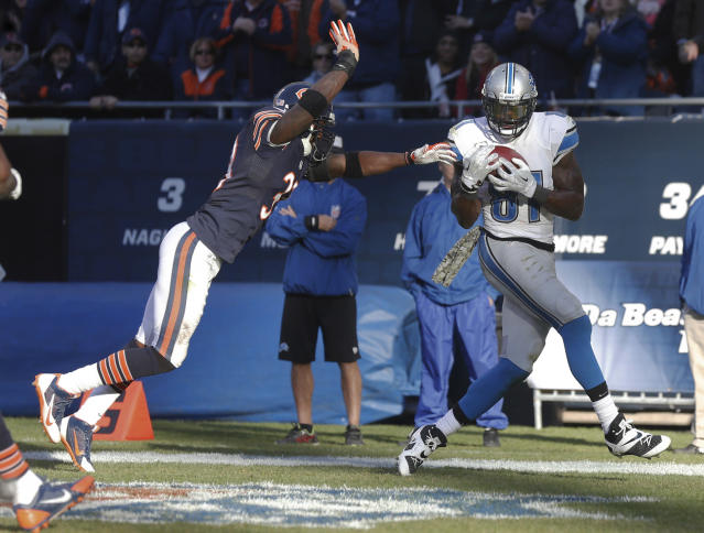 Detroit Lions wide receiver Calvin Johnson (81) makes a touchdown reception in front of Chicago Bears cornerback Charles Tillman (33) during the second half of an NFL football game, Sunday, Nov. 10, 2013, in Chicago. The Lions won 21-19. (AP Photo/Charles Rex Arbogast)