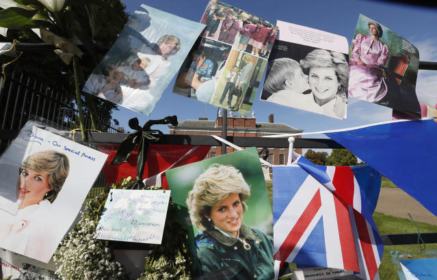 <p>Pictures and flags hang on the gates of Kensington Palace in London to pay tribute to the late Diana, Princess of Wales, Aug. 31, 2017. (Photo: Kirsty Wigglesworth/AP) </p>