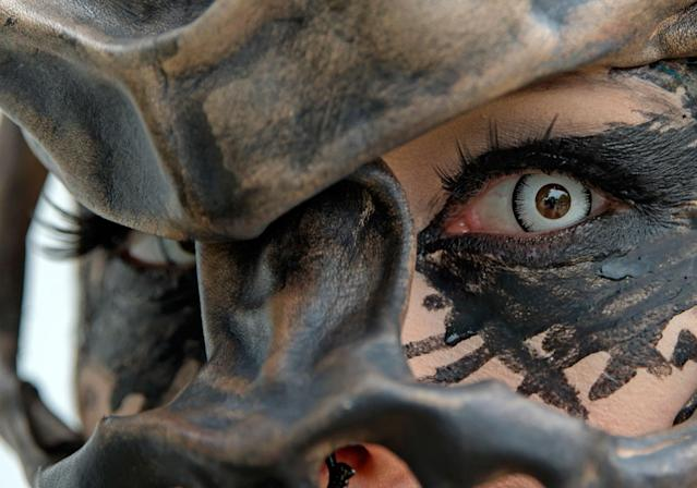<p>A participant in a fancy costume attends the Wave Gothic Festival (WGT) in Leipzig, Germany, Saturday, June 3, 2017. (AP Photo/Jens Meyer) </p>