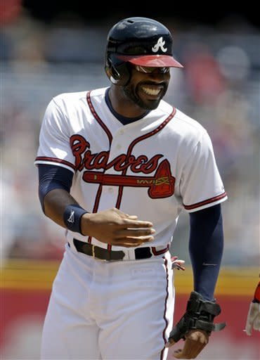 Atlanta Braves' Jason Heyward smiles after hitting a single to score teammate Jordan Schafer in the first inning of a baseball game against the Minnesota Twins, Wednesday, May 22, 2013, in Atlanta. (AP Photo/David Goldman)