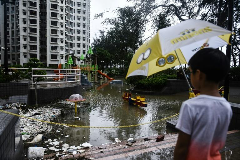 Hong Kong shuts down as powerful typhoon hammers through