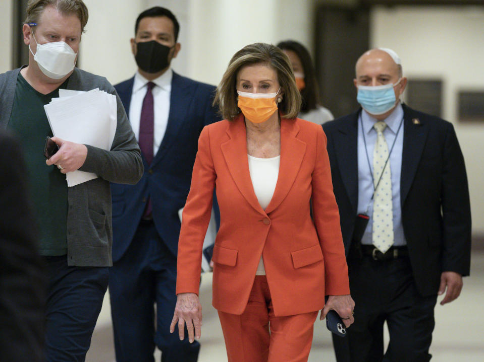 Speaker of the House Nancy Pelosi, D-Calif., arrives for her weekly news conference at the Capitol in Washington, Thursday, March 11, 2021. (AP Photo/J. Scott Applewhite)