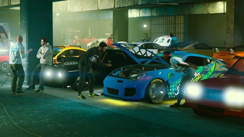 Grand Theft Auto Online characters look over their cars in a musty garage.