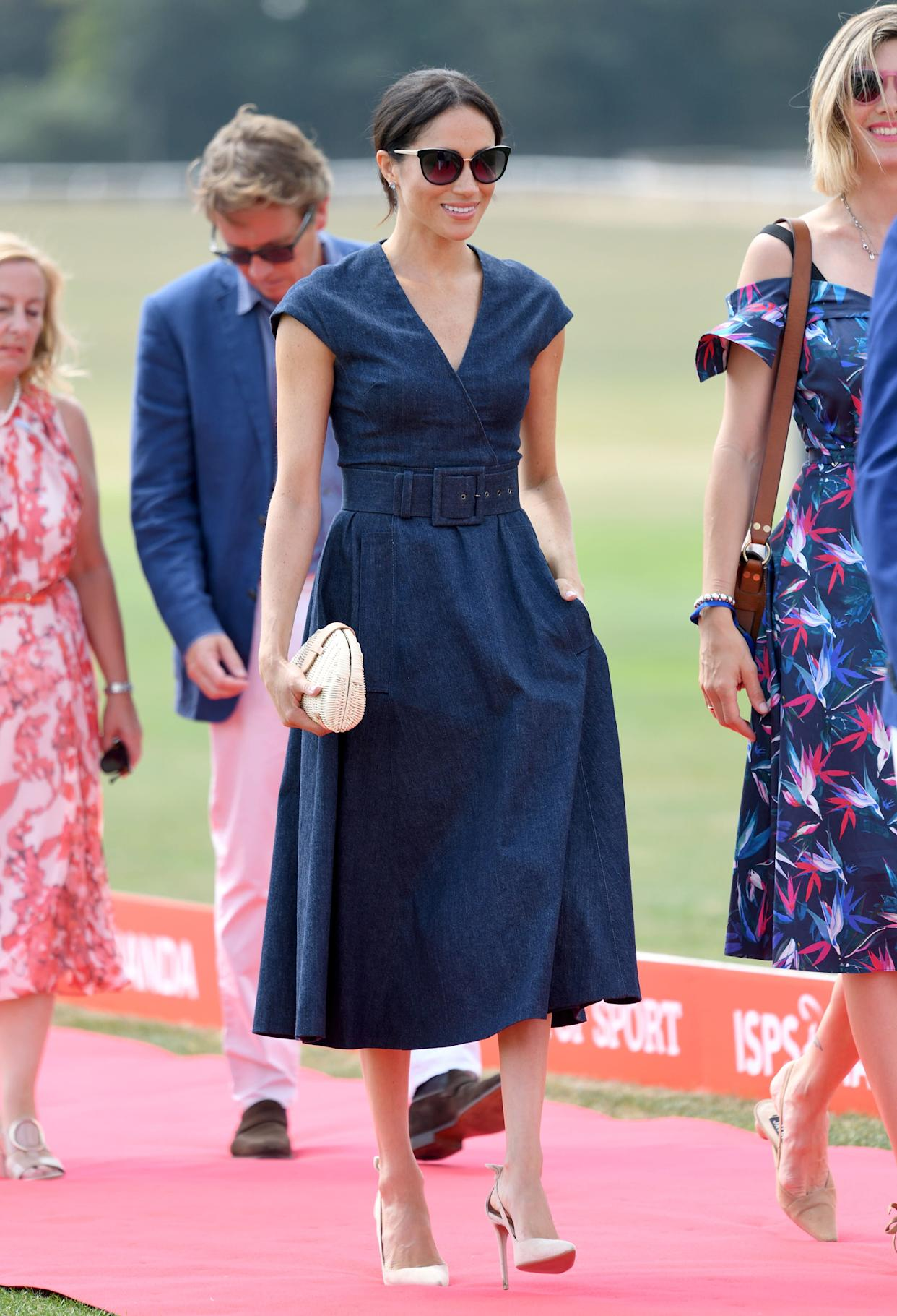 The duchess attends the Sentebale ISPS Handa Polo Cup at the Royal County of Berkshire Polo Club on July 26 in Windsor, England.
