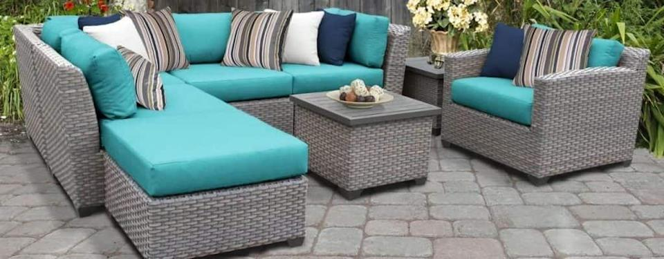 Merlyn 8 Piece Rattan Sectional Seating Group with Cushions