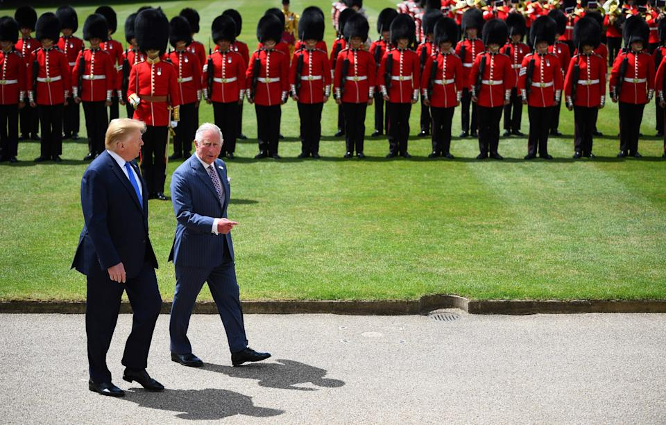 President Trump and the Prince of Wales walk side by side after inspecting the honour guard on the Buckingham Palace lawn. (VICTORIA JONES/AFP/Getty Images)