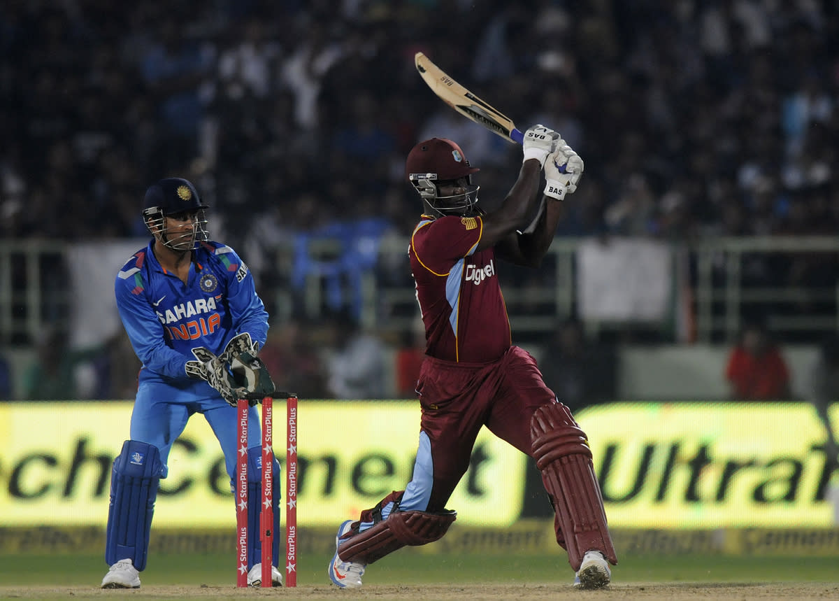 Darren Sammy of West Indies bats during the second Star Sports One Day International (ODI) match between India and The West Indies held at the Dr. Y.S. Rajasekhara Reddy ACA-VDCA Cricket Stadium, Vishakhapatnam, India on the 24th November 2013  Photo by: Pal Pillai - BCCI - SPORTZPICS   Use of this image is subject to the terms and conditions as outlined by the BCCI. These terms can be found by following this link:  https://ec.yimg.com/ec?url=http%3a%2f%2fsportzpics.photoshelter.com%2fgallery%2fBCCI-Image-Terms%2fG0000ahUVIIEBQ84%2fC0000whs75.ajndY&t=1490639783&sig=8DPcE.gEi6FvDDJScpw4xw--~C
