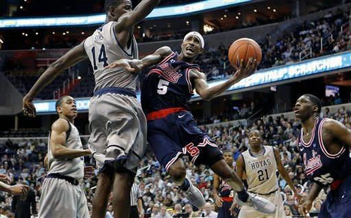 Memphis' Will Barton (5) is fouled on his way to the basket by Georgetown's Henry Sims, left, during second half of an NCAA college basketball game on Thursday, Dec. 22, 2011, in Washington. (AP Photo/ The Commercial Appeal, Mark Weber) NO SALES; MAGS OUT; TV OUT; MEMPHIS OUT