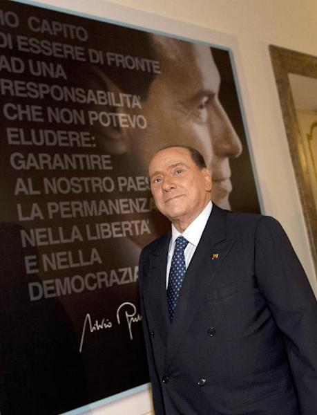 Italy's former Prime Minister Silvio Berlusconi attends the inauguration of the new PDL party headquarters, in Rome, on September 19, 2013
