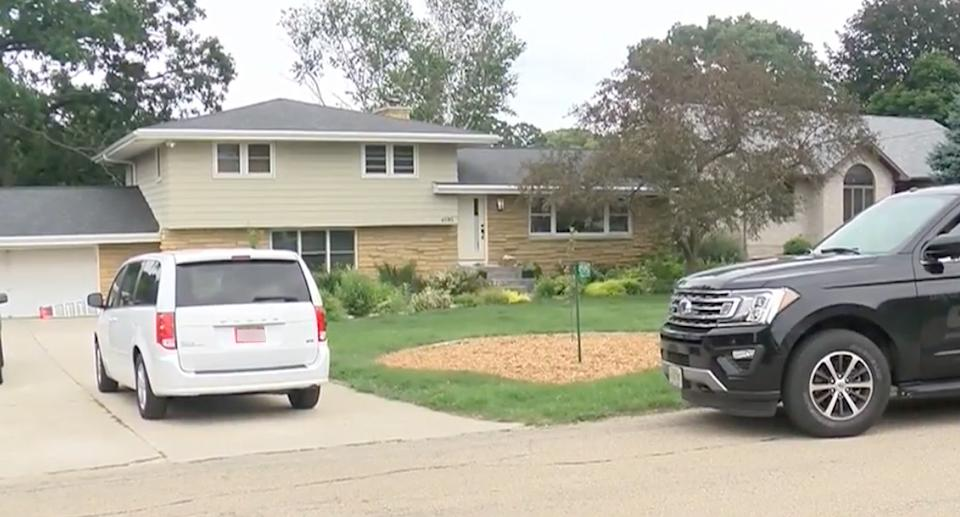 The couple's Windsor, Wisconsin home with two cars parked out the front. Source: WKOW
