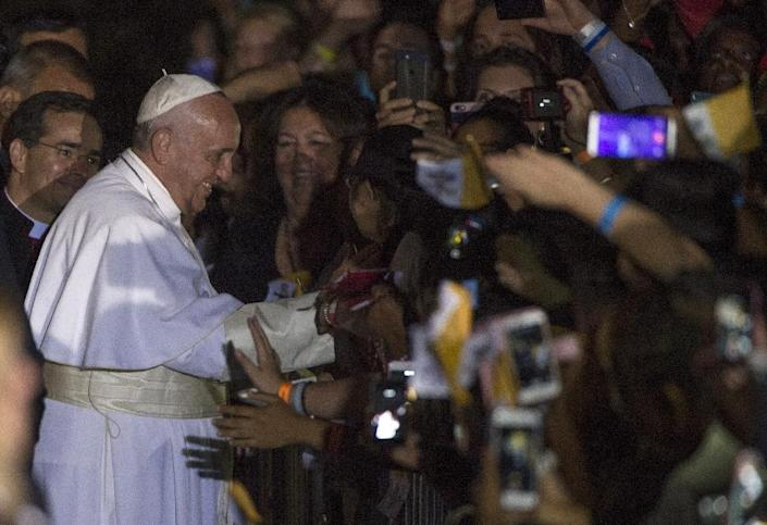 Pope Francis waded into another bitter US political debate when he urged the church to embrace new immigrants (AFP Photo/Molly Riley)
