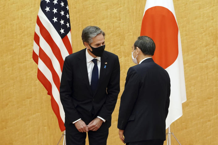 Japanese Prime Minister Yoshihide Suga, right, meets with U.S. Secretary of State Antony Blinken, left, during a courtesy call at the prime minister's official residence Tuesday, March 16, 2021. Defense and foreign ministers from the U.S. and Japan are meeting to discuss their concern over China's growing influence in the Indo-Pacific region as the Biden administration tries to reaffirm engagement with its key regional allies.(AP Photo/Eugene Hoshiko, Pool)
